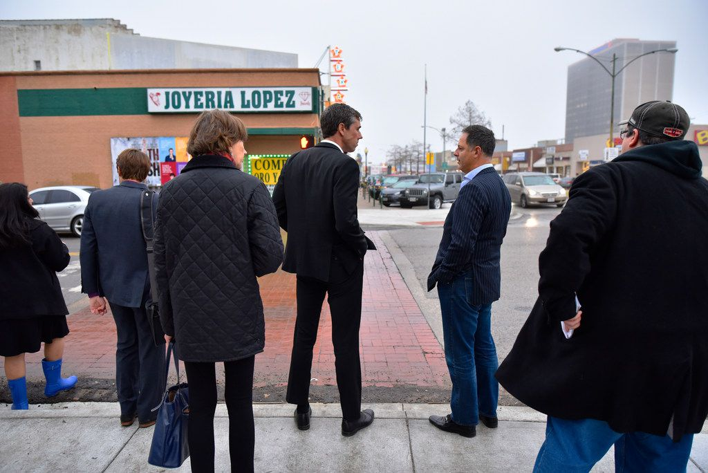 Democratic Senate candidate Beto O'Rourke (center) speaks with state Rep. Rafael Anchia (right) as they stand on the corner of Madison Avenue and Jefferson Boulevard on their way to a town hall meeting at the Texas Theatre in Oak Cliff on Feb. 23.