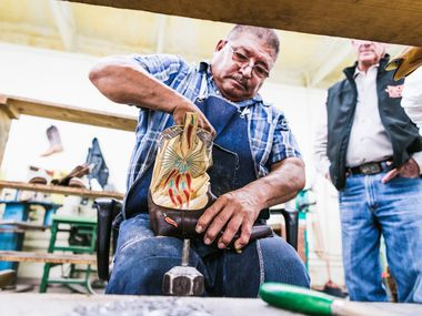 A craftsman in Mercedes, Texas works on a pair of boots for Dallas-based Miron Crosby, which has its storefront in Highland Park Village.