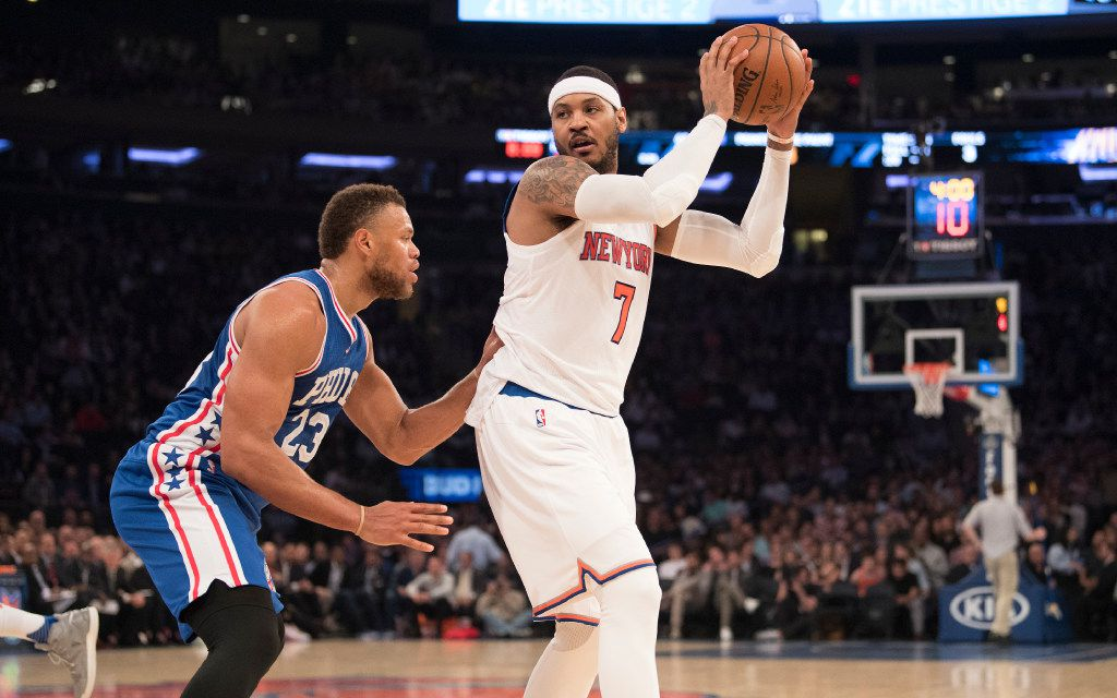 Carmelo Anthony, working here against former Maverick Justin Anderson, could be moving out of New York, but the market has not yielded a lot of interest in the high-scoring forward so far. (Ben Solomon/The New York Times)