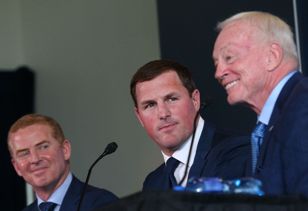 Dallas Cowboys tight end Jason Witten and head coach Jason Garrett look over to Dallas Cowboys owner Jerry Jones speaking after Witten announced his retirement from the NFL during a news conference at The Star in Frisco, Texas on Thursday, May 3, 2018. (Rose Baca/The Dallas Morning News)
