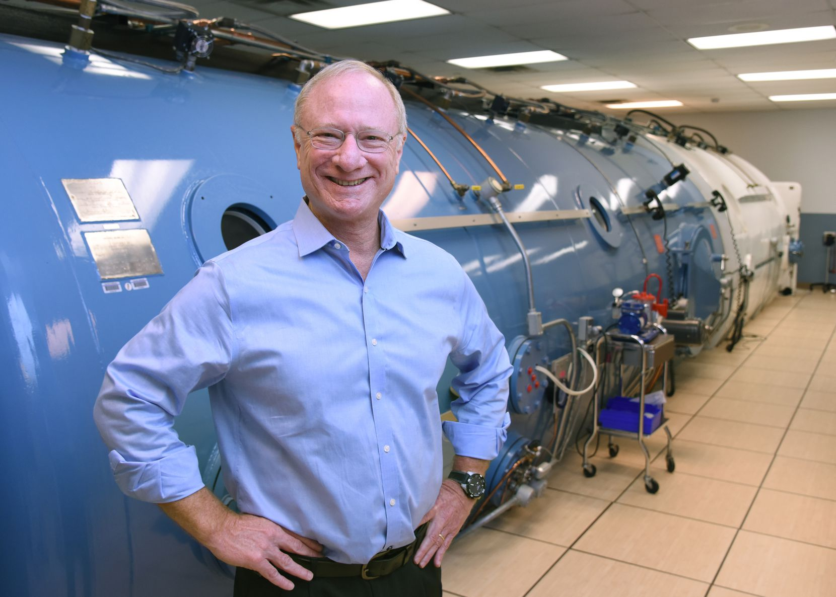 Dr. Benjamin Levine, director of the Institute for Exercise and Environmental Medicine, stands in front of his laboratory's hyper/hypobaric environmental chamber, which is used to simulate high altitude, deep diving, and space-like conditions in his studies of human performance