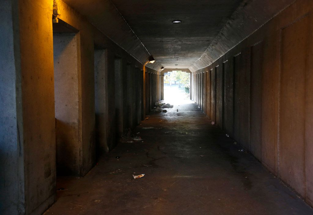 The view west through one of the smelly, trash-strewn tunnels leading from Dealey Plaza  under the railroad tracks toward Martyrs Park