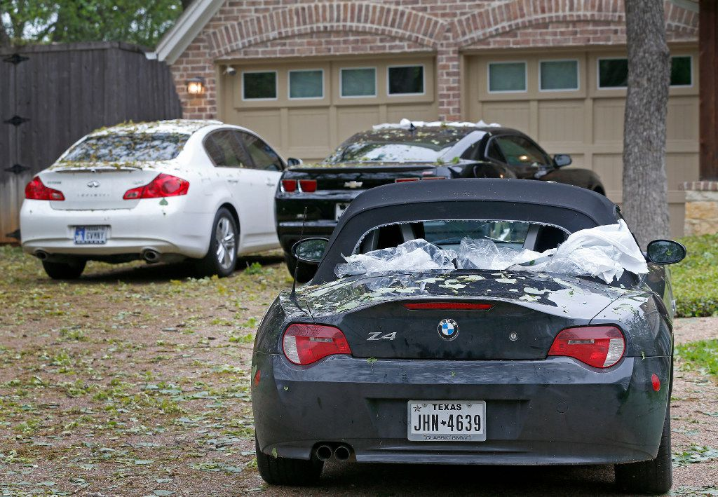 A back windshield is damaged by last night's hailstorm sitting in a driveway on Lake Vista North in Highland Village, Texas, Monday, March 27, 2017. (Jae S. Lee/The Dallas Morning News)