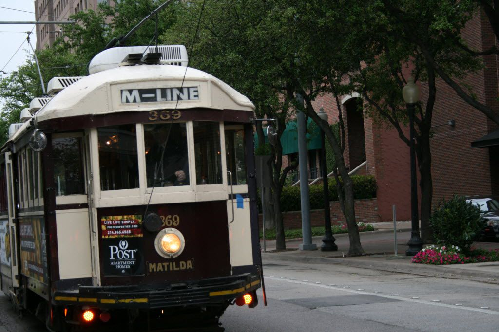 Matilda, a McKinney Avenue Trolley, rides past on the streets of Uptown. (File)