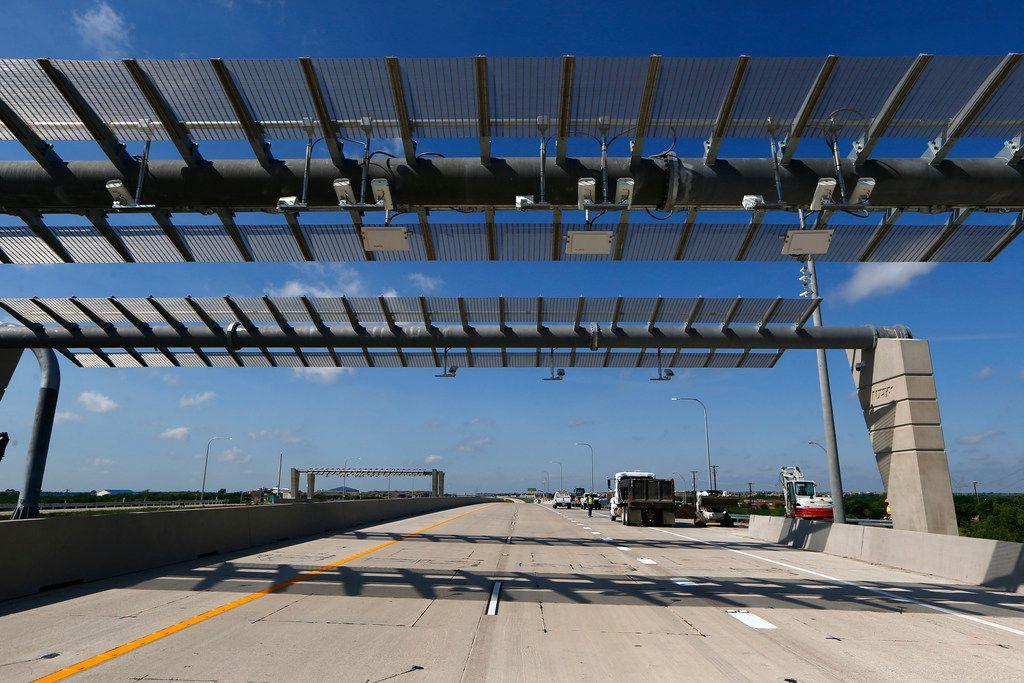 The toll monitor on highway extension of State Highway 360 in Grand Prairie. Cost to drive the 9.7 miles of the North Texas Tollway Authority's 360 Tollway will be $1.62. (Nathan Hunsinger/The Dallas Morning News)