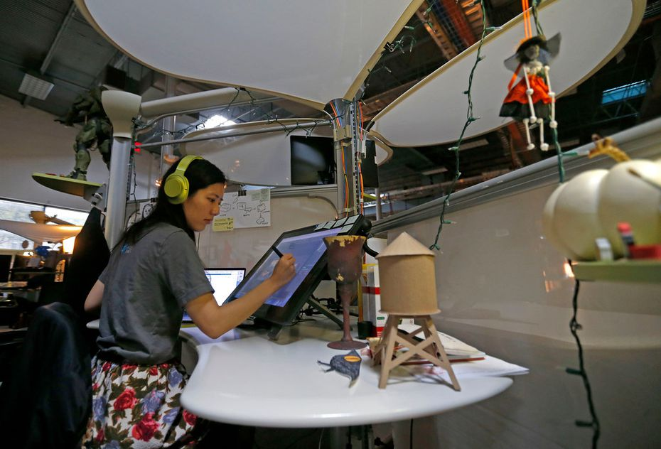 Art director Ruby Wang works on game characters at Flight School Studios, a video game developer embedded in Reel FX Studios in Dallas, Friday, March 23, 2018.