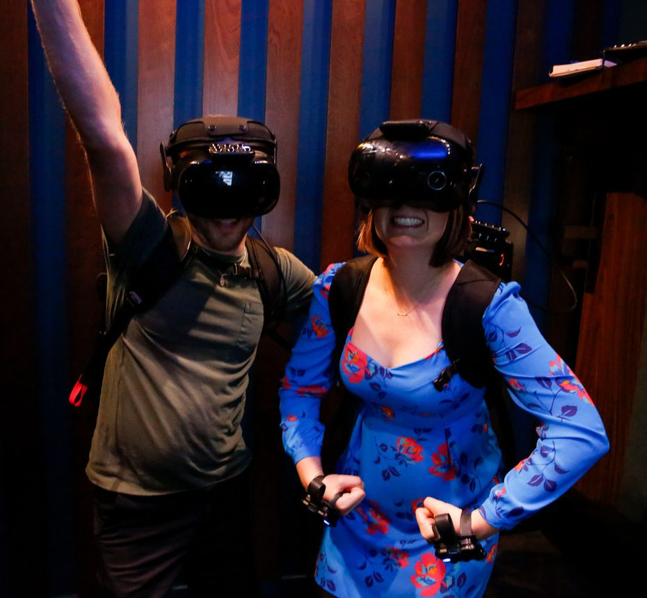 Photography wasn't allowed inside the theaters. So here's Sarah Blaskovich and Britton Peele all geared up and ready to try a VR experience at Dreamscape.