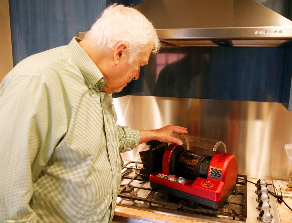 Keith Marton takes a closer look as he roasts Sweet Maria's Brazil Dry Process Serrinha Yellow Bourbon green coffee beans roast in a Gene Cafe roaster at his home in Dallas.