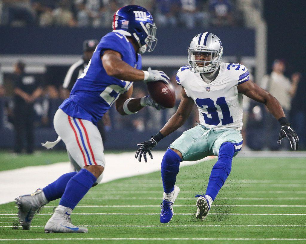Dallas Cowboys cornerback Byron Jones (31) works to put a stop to New York Giants running back Saquon Barkley (26) during a matchup between the Dallas Cowboys and the New York Giants on Sunday, Sept. 16, 2018 at AT&T Stadium in Arlington, Texas. (Ryan Michalesko/The Dallas Morning News)