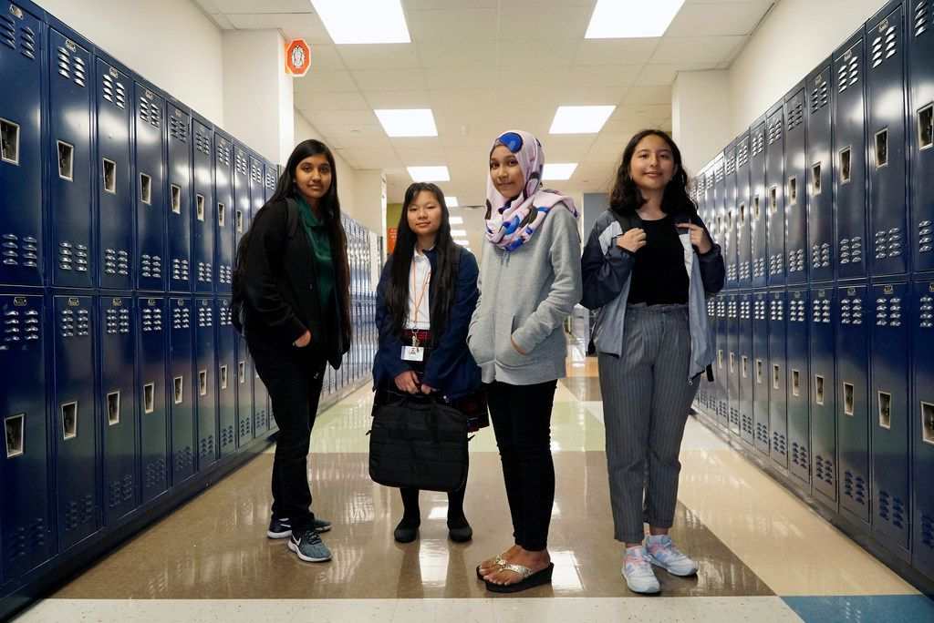 Liliana Chavez (13), Hser Eh Doh (13), Syahira Noor Bashar (13), and Briana Barron (15), at Tasby Middle School in Dallas on Oct. 3, 2019. The girls helped create a guide for immigrant students new to the United States.