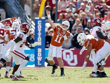 Texas Longhorns quarterback Sam Ehlinger (11) attempts a pass in a game against Oklahoma Sooners during the first half of play in the Red River Showdown at the Cotton Bowl in Dallas on Saturday, October 12, 2019. (Vernon Bryant/The Dallas Morning News)