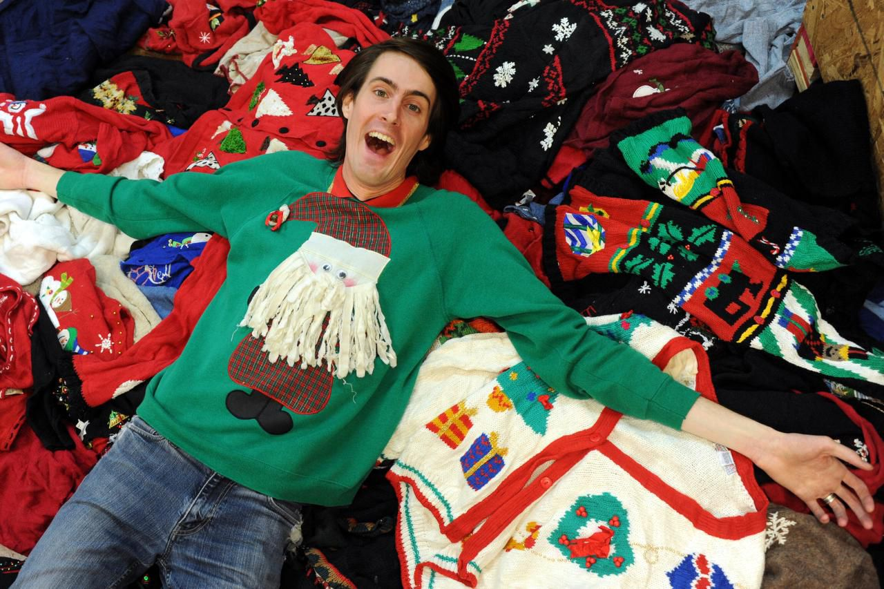 """Everyone knows I'm the original store,"" says Jeremy Turner (above), who owns the Ugly Christmas Sweater Shop. But ""I look at myself as the original ugly Christmas sweater store,"" says Mindi Kahn, owner of That Ugly Christmas Sweater Store."