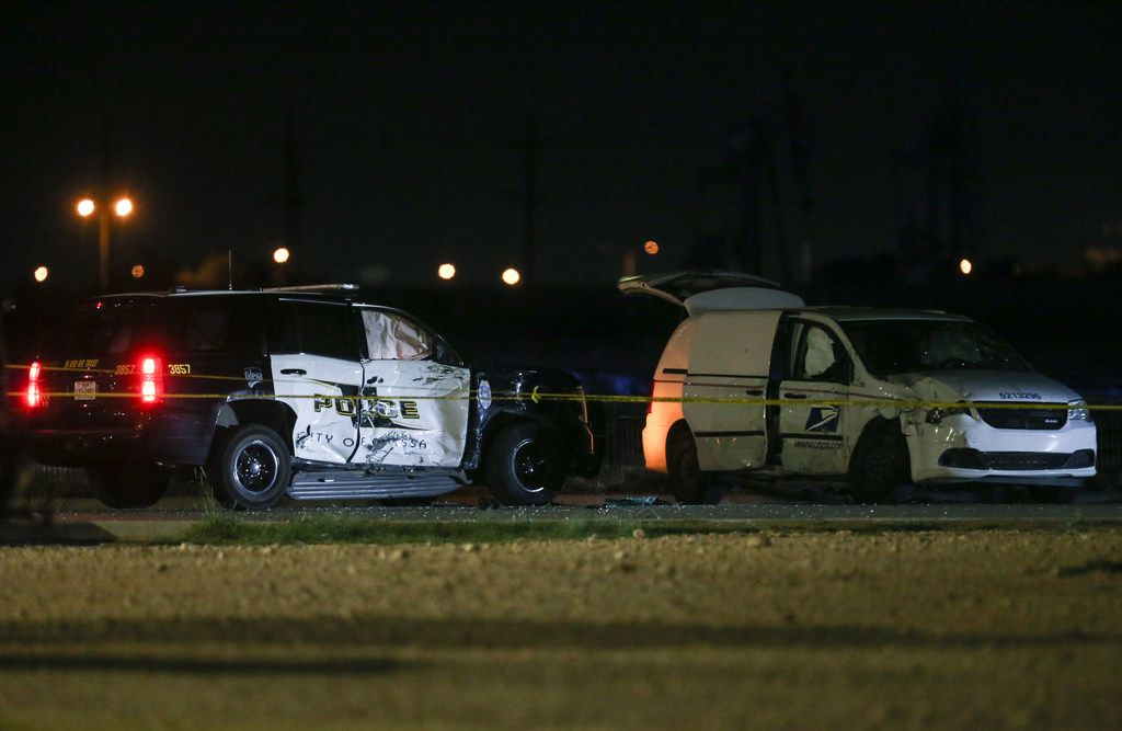 A crashed U.S. Postal Service vehicle and Odessa Police vehicle are seen Saturday, Aug. 31, 2019 at a Cinergy movie theatre in Odessa, Texas. At least five people died after more than 20 people were shot Saturday when a gunman hijacked a postal truck and began shooting randomly in the Odessa area of West Texas, authorities say.(Ryan Michalesko/The Dallas Morning News)