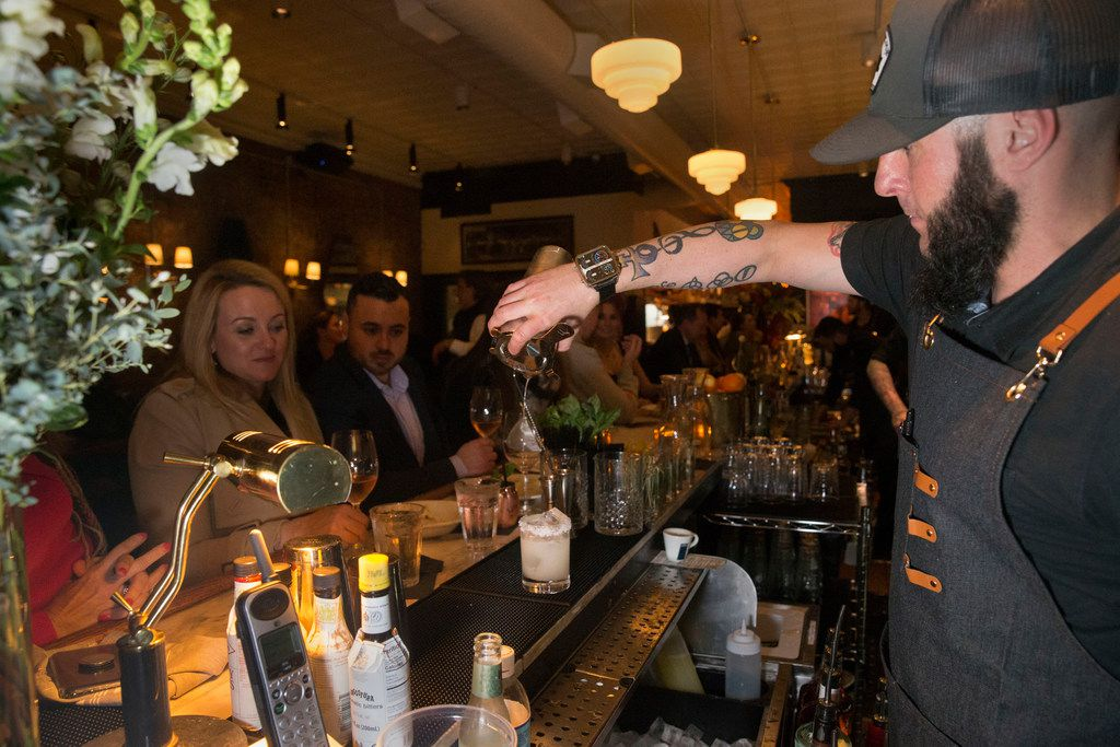 A bartender pours a mixed drink at Alamo Club, not far from where a woman was killed last Monday.