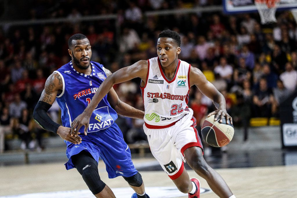 Professional player Frank Ntilikina (right), one of French basketball's promising players, whose name is on the NBA Draft Early Entry List, announced as a potential top-10 prospect in the upcoming 20117 NBA draft. Photo by Andia/Sipa USA(Sipa via AP Images) ORG XMIT: NYWWP