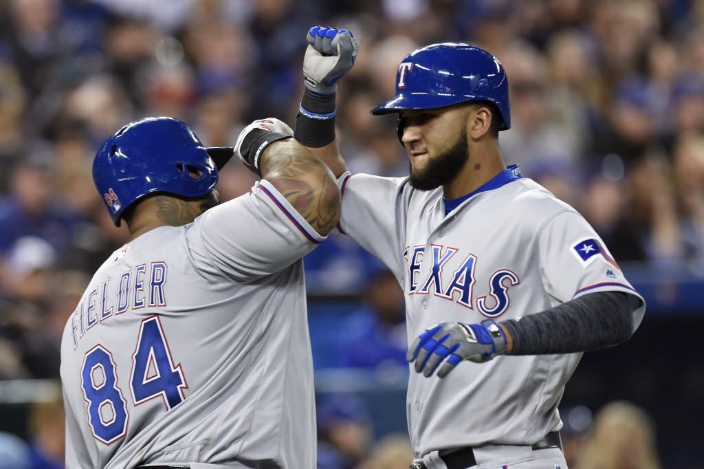 Texas Rangers' Nomar Mazara, right, celebrates with teammate Prince Fielder after hitting a solo home run against the Toronto Blue Jays during eighth inning American League baseball action in Toronto on Monday, May 2, 2016. (Frank Gunn/The Canadian Press via AP) MANDATORY CREDIT