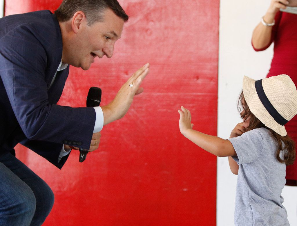 Christian Christy, 3, ended up on the stage with Sen. Ted Cruz before he started talking with voters during a retail stop at Tin Roof BBQ in Humble Texas, on Saturday, September 8, 2018. Ted Cruz campaigned in Humble, Texas, Texas on Saturday, while Beto O'Rourke campaigned a few miles away in Houston, Texas.