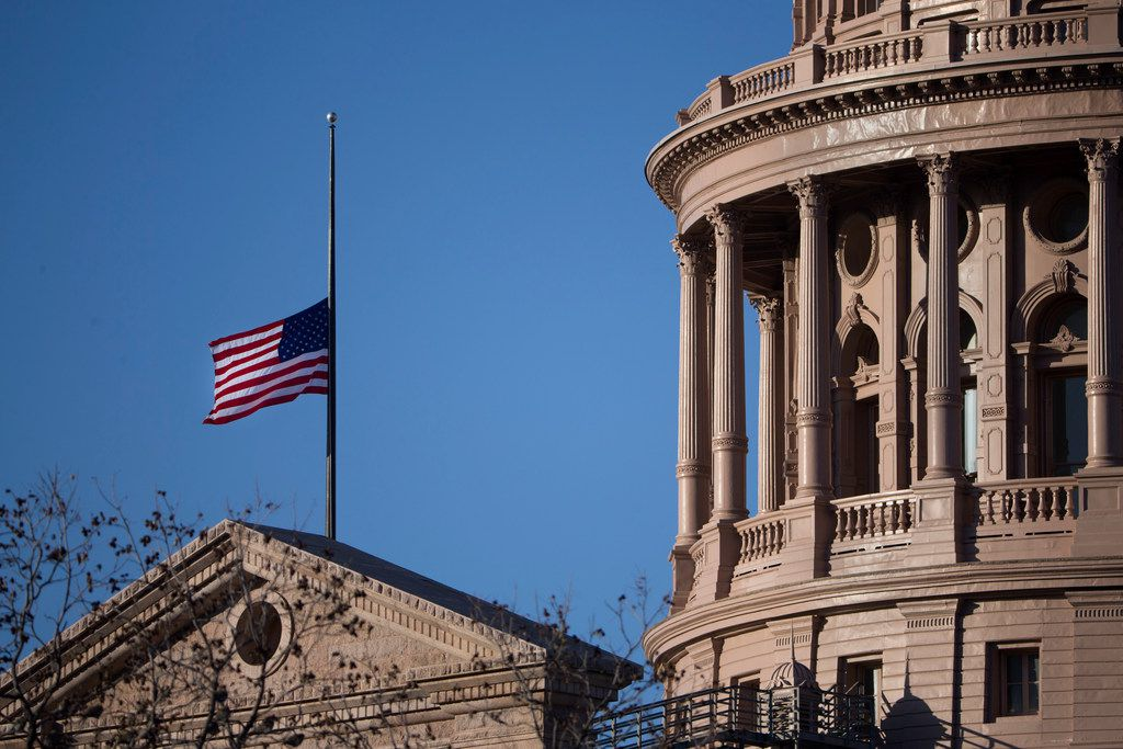 The U.S. flag flies at half staff over the Texas Capitol in honor of former President George H.W. Bush in December 2018.