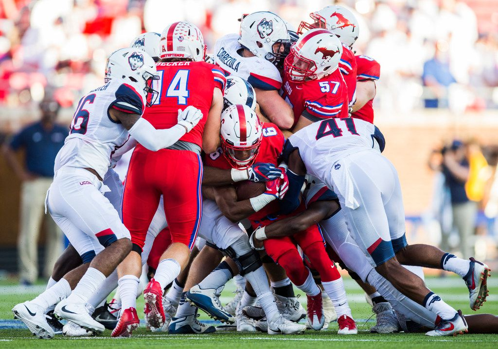Southern Methodist Mustangs running back Braeden West (6) is tackled during the fourth quarter of a football game between the University of Connecticut and SMU Texas on Saturday, September 30, 2017 at SMU's Ford Stadium in Dallas. (Ashley Landis/The Dallas Morning News)