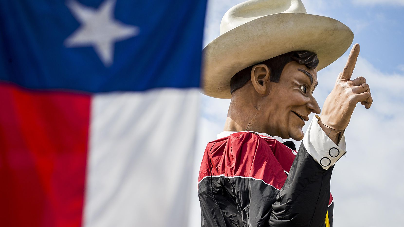 Big Tex looks down over Fair Park while being installed on Friday, Sept. 23, 2016, in Dallas. The State Fair of Texas opens on September 30 and runs through October 23.
