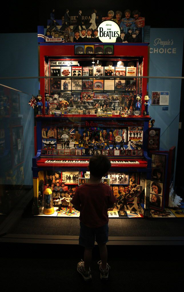 Knox MacFadyen, 4, looks at a collection of Beatles memorabilia, part of the Eye of the Collector exhibit at the Perot Museum of Nature and Science in Dallas on April 14, 2016.
