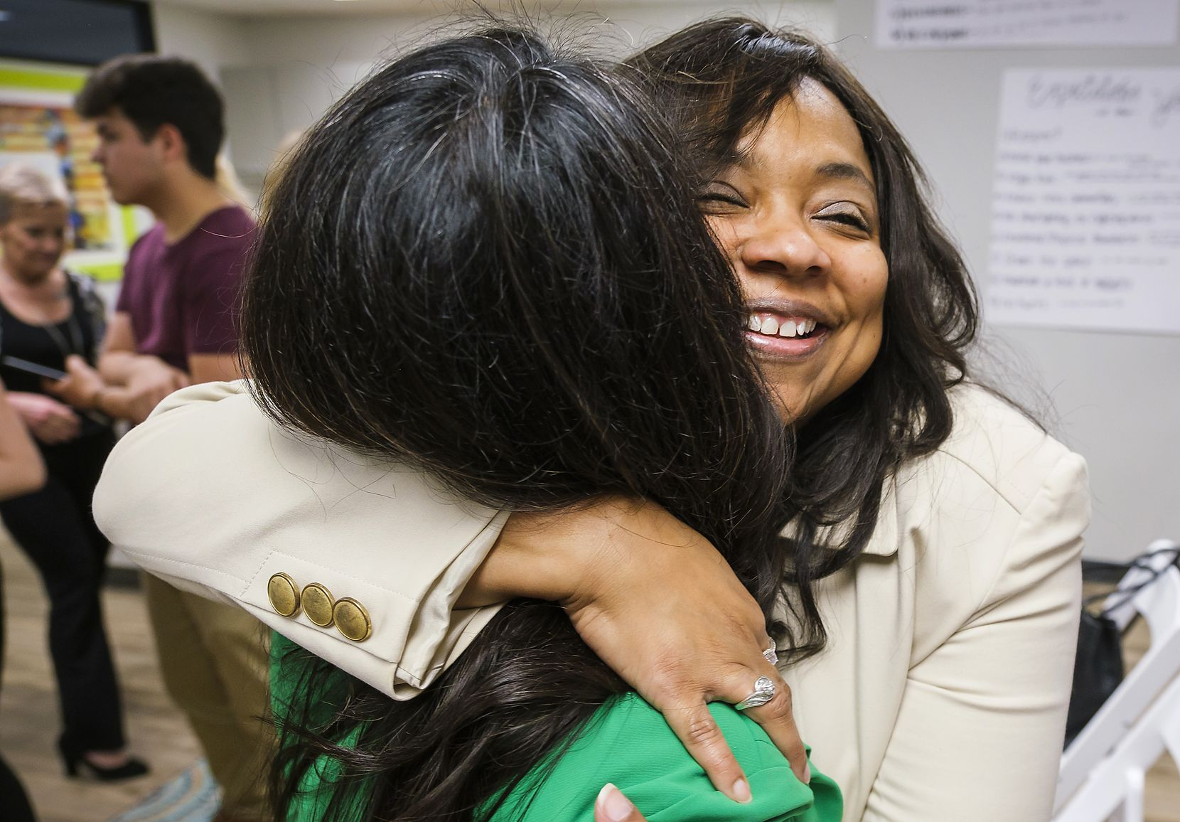 Lavinia Masters hugs Rep. Victoria Neave after Gov. Greg Abbott signed House Bill 8 during a bill signing ceremony at New Friends New Life on Tuesday, June 4, 2019, in Dallas. House Bill 8 is named after Masters, a Dallas survivor whose rape kit sat on a shelf for more than 21 years after she was raped at knifepoint in her home when she was 13. The governor signed legislation related to human trafficking and the elimination of the rape kit backlog.