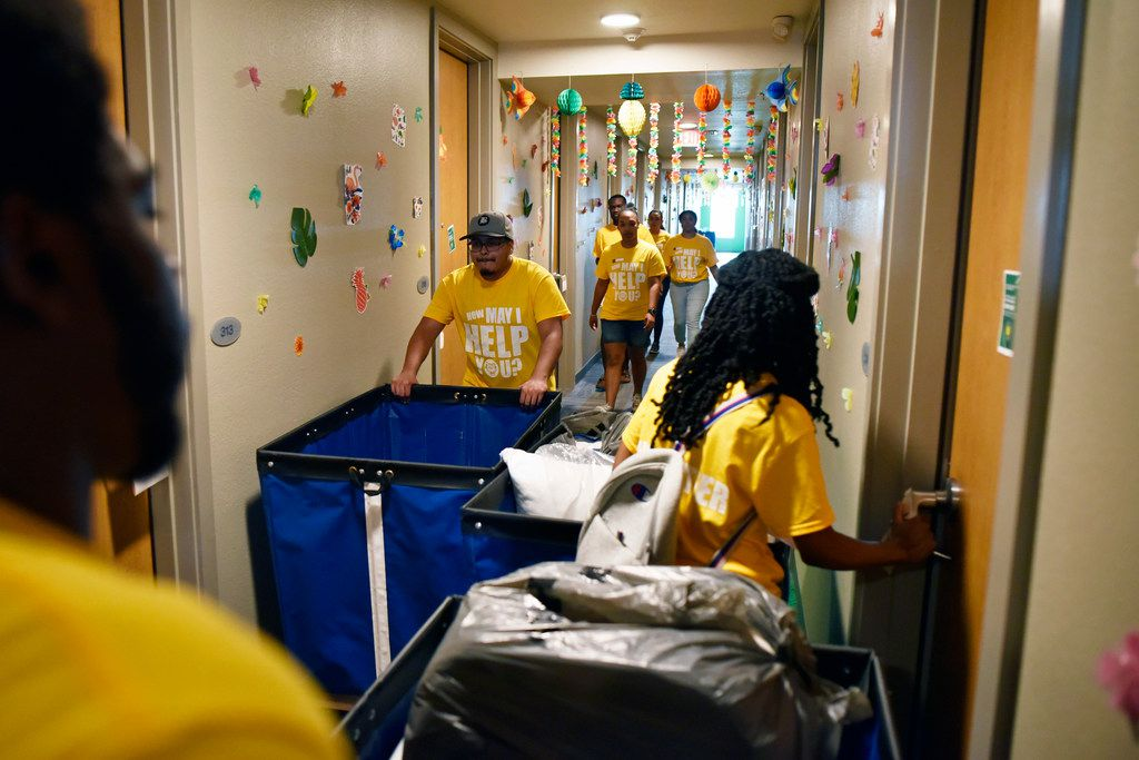 Resident Hall Association president Juwon Grant (left), secretary Alexis Edwards (right)and other members  unloaded carts full of student belongings as freshman moved into the dorm at the University of North Texas at Dallas on Saturday.