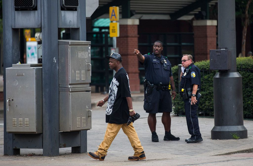 DART officers talk at the West End DART station in downtown Dallas.