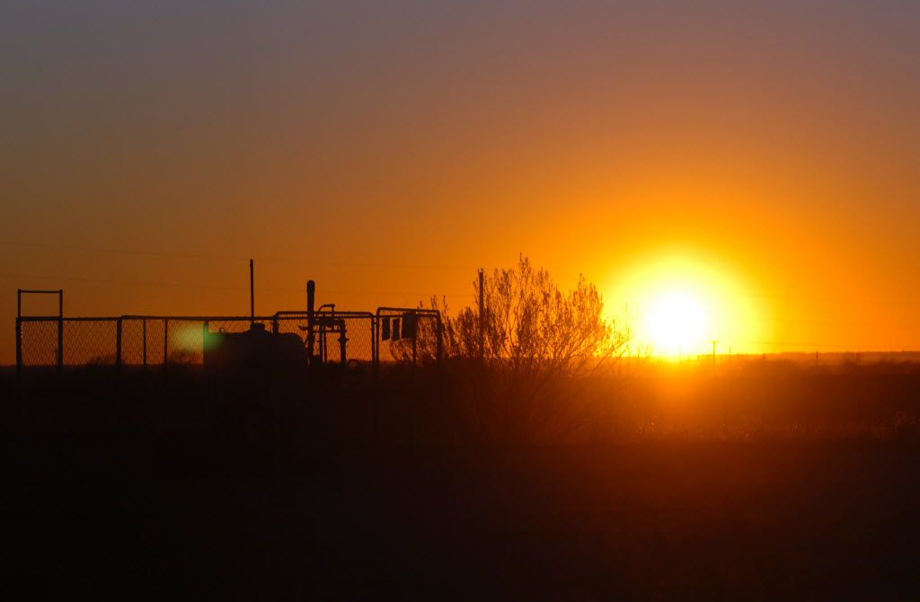 The sun sets behind Devon Energy's East Ponder Well No. 4, Thursday, January 5, 2012, in Ponder, Texas. (David Minton / Staff Photographer / Denton Record-Chronicle)