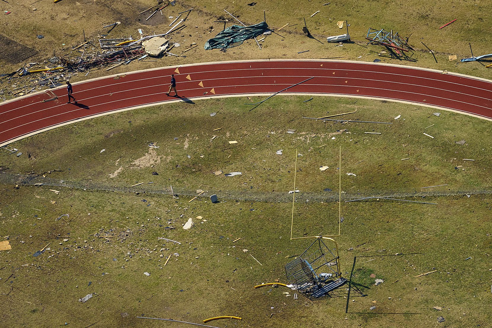 Storm debris lies scattered on an athletic field at Thomas Jefferson High School.