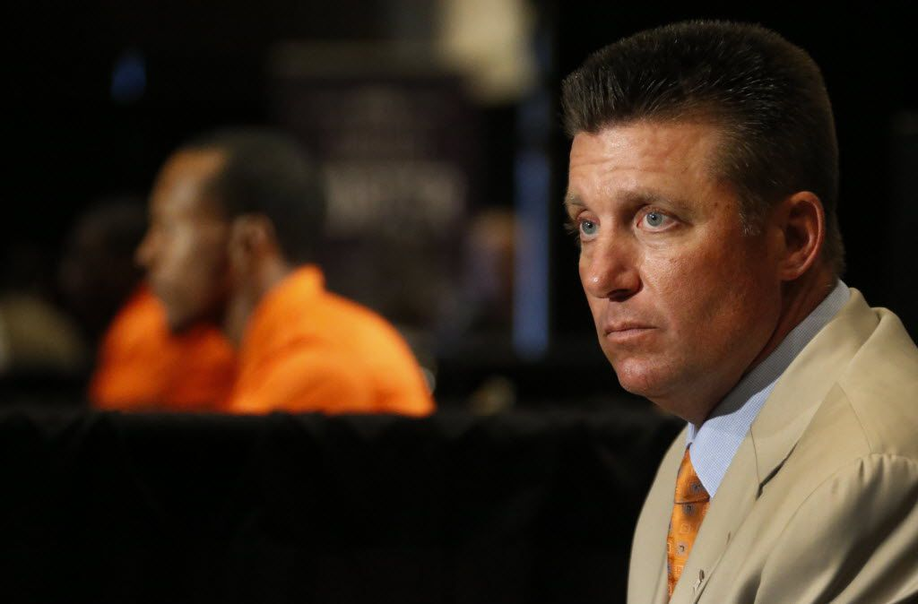 Oklahoma State head coach Mike Gundy listens to questions from the media during the Big 12 Conference Football Media Days held at the Omni Hotel in downtown Dallas on Monday, July 21, 2014.  (Louis DeLuca/The Dallas Morning News)