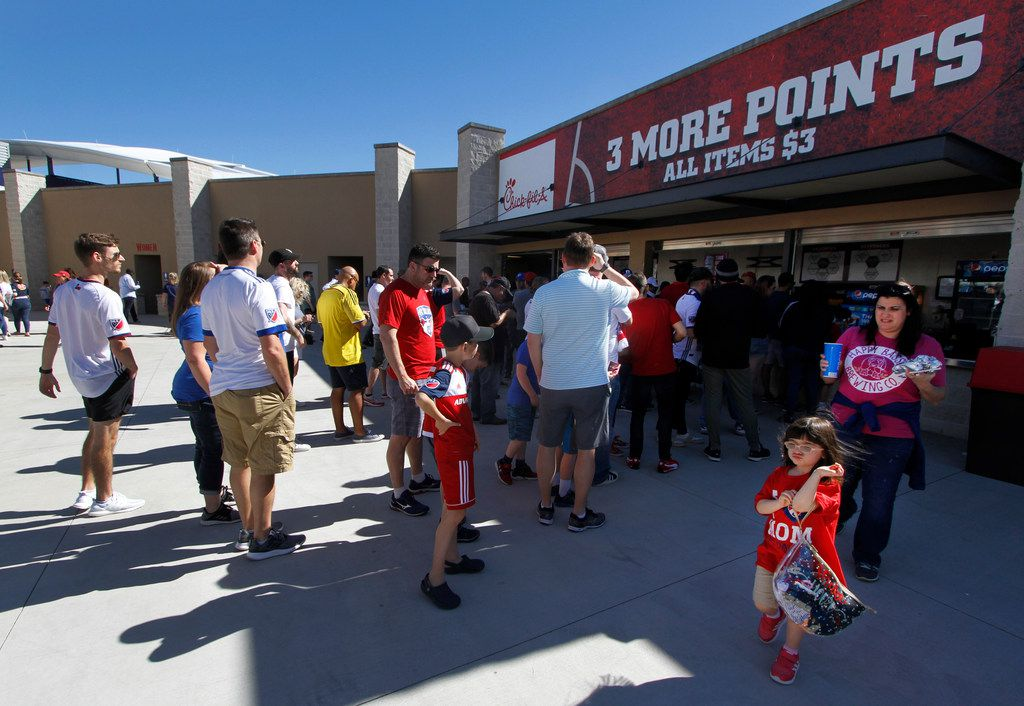 FC Dallas fans visit the Three more points concession stand before the start of the FC Dallas versus LA Galaxy soccer game. The fan friendly stand offers several items for $3. and are located in the upper concourse in sections 112 and 120 on the south corners of the stadium. The two Major League Soccer teams played their game at Toyota Stadium in Frisco on March 9, 2019. (Steve Hamm/ Special Contributor)