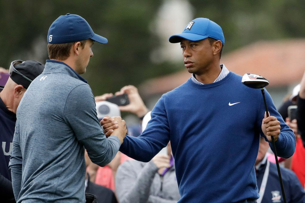 Jordan Spieth, left, and Tiger Woods shake hands on the 10th hole during the second round of the U.S. Open Championship golf tournament Friday, June 14, 2019, in Pebble Beach, Calif. (AP Photo/Marcio Jose Sanchez)
