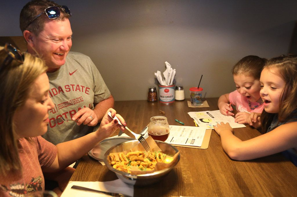 Josh and Kerri Fulks with daughter Sophia, 7, rear, and Blaire McGuire (daughter of owner Barian McGuire) during the 'friends and family' dinner at the new restaurant, Rotolo's Craft & Crust, in Frisco, Texas Saturday, Sept. 29, 2018. (Anja Schlein/Special Contributor)