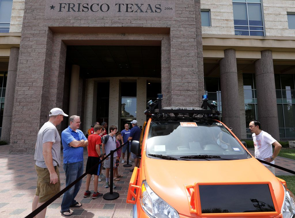 Community members examine a Drive.ai van during a town hall at the George Purefoy Municipal Center in Frisco on July 21, Starting on July 30, the autonomous vehicles will be rolling through streets in the city.
