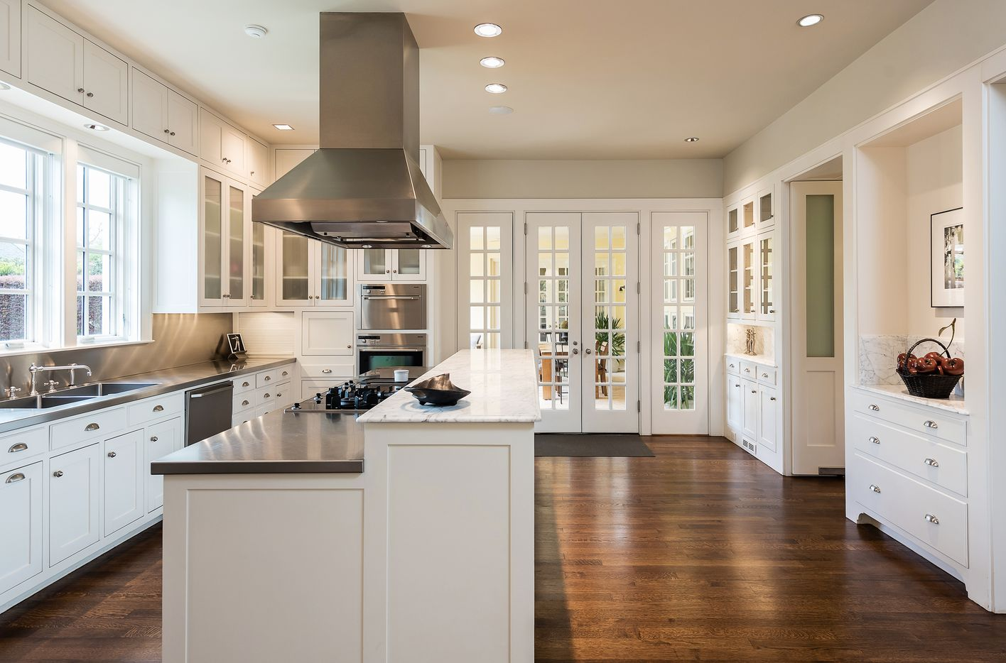 The light-filled kitchen leads to a patio.