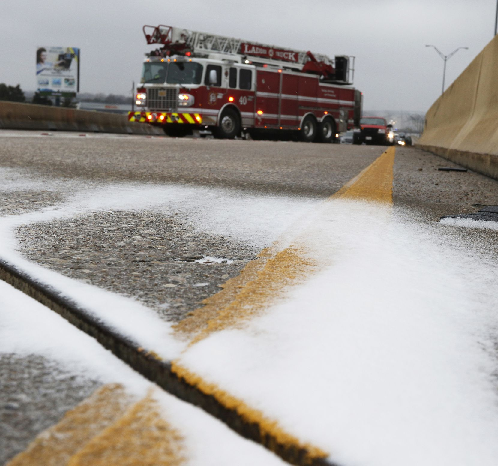 Ice covered the overpass on Highway 67 over Hampton Road on Sunday afternoon in Dallas. The Dallas Fire Department was waiting for sand trucks.