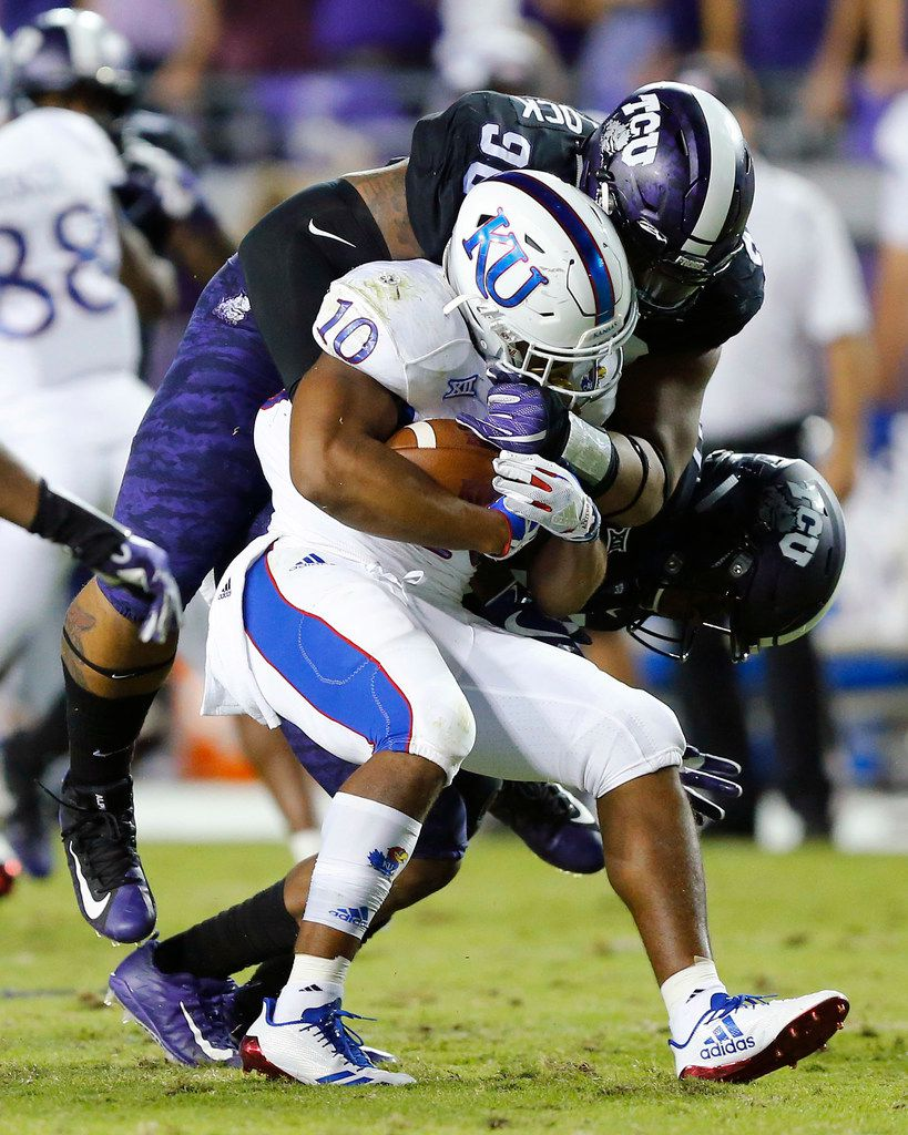 TCU Horned Frogs defensive tackle Ross Blacklock (90) tackles Kansas Jayhawks running back Khalil Herbert (10) in the backfield during the first half at Amon G. Carter Stadium in Fort Worth, Texas, Saturday, October 21, 2017. (Tom Fox/The Dallas Morning News)