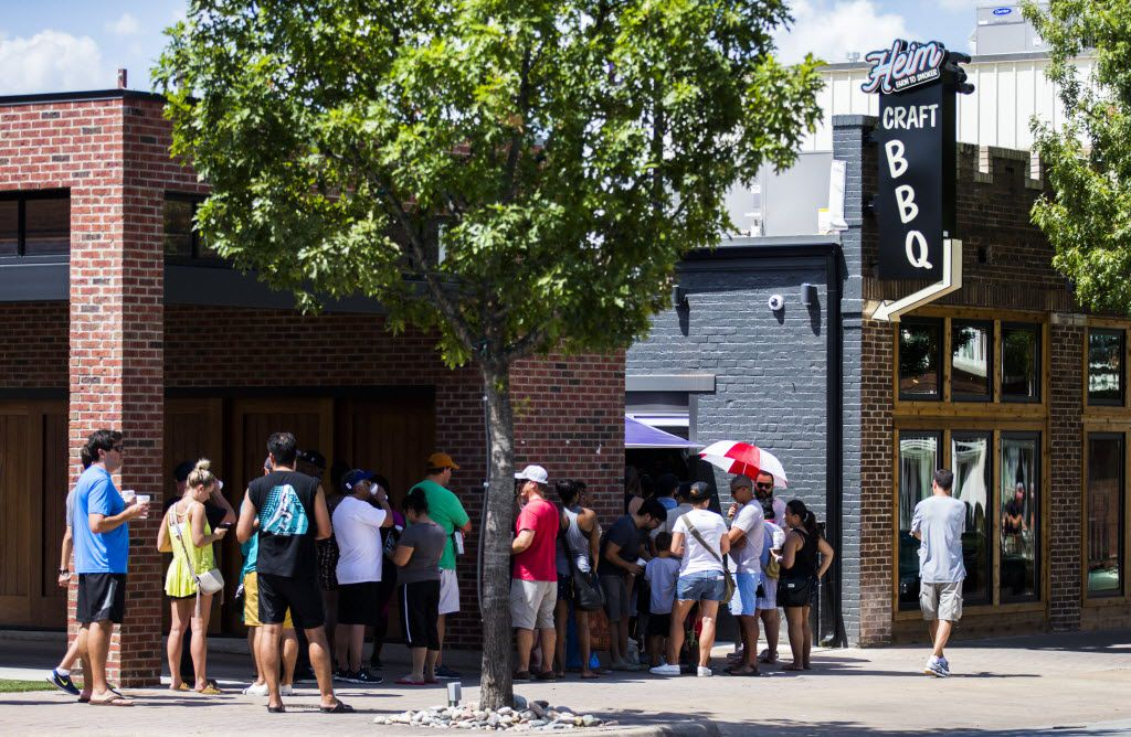 A line wraps around the block as Heim Barbecue opens a new location on Saturday, August 6, 2016 on W. Magnolia Ave. in Fort Worth.
