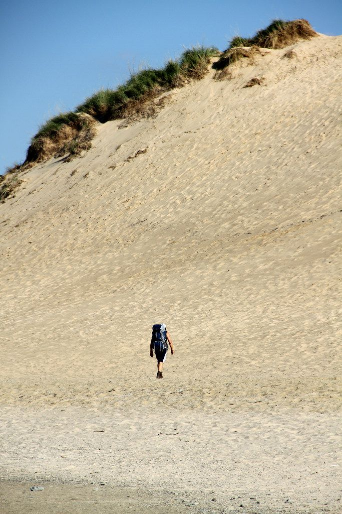 A hiker walks near Mount Baldy, which rises 126 feet above the shore of Lake Michigan.