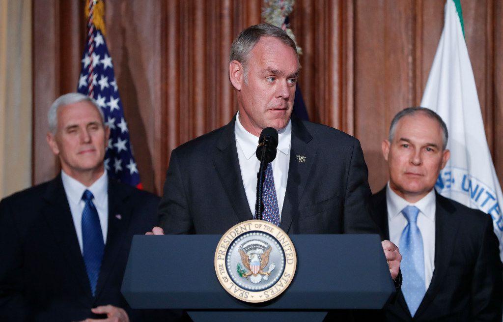 Interior Secretary Ryan Zinke speaks at EPA headquarters in Washington on Tuesday before President Trump signed an executive order unraveling Obama era regulations.