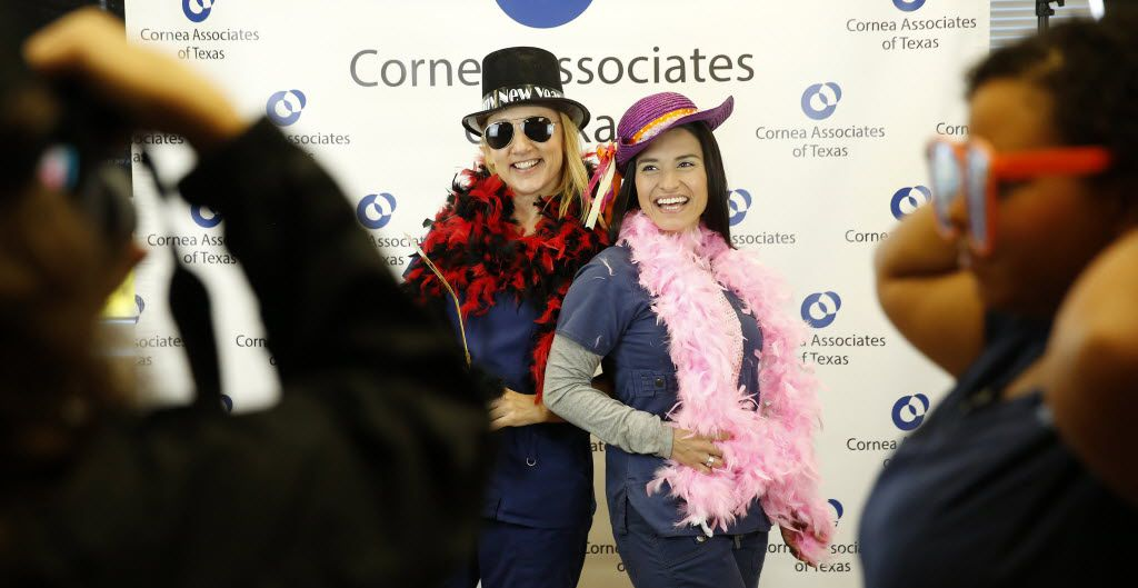 Ophthalmic technician Mira Korths (left) and technician Veronica Livaudais pose in a photo booth.