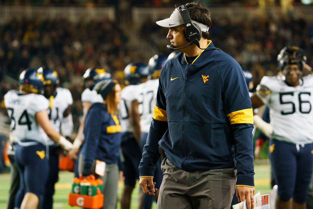 West Virginia head coach Neal Brown watches during a time out during the first half of an NCAA football game against Baylor at McLane Stadium on Thursday, Oct. 31, 2019, in Waco, Texas. (Smiley N. Pool/The Dallas Morning News)
