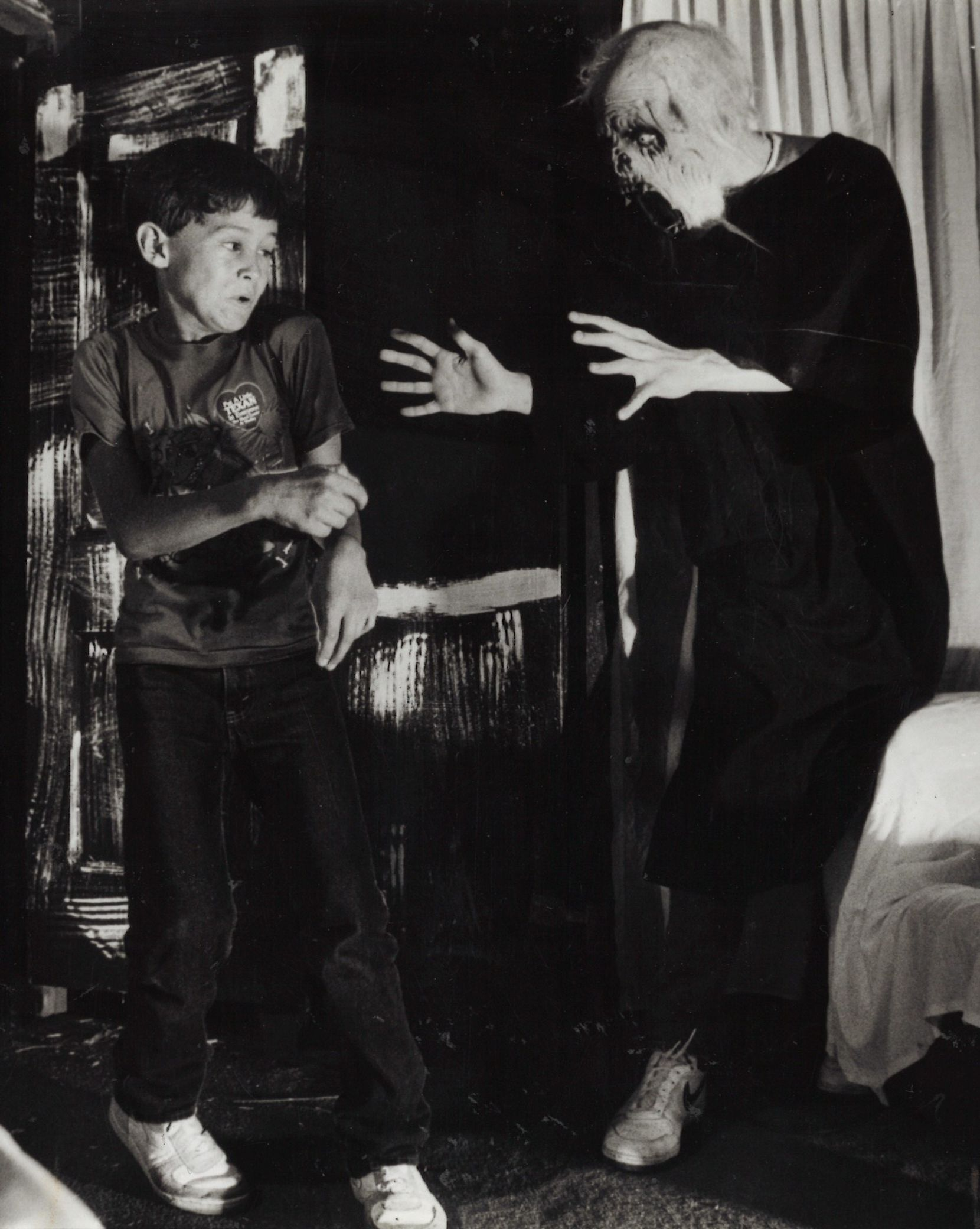 Jason Works gets a scare from ghoul Craig Faukner, a student at Garland High School, during preview night for the March of Dimes Haunted House in October 1986.