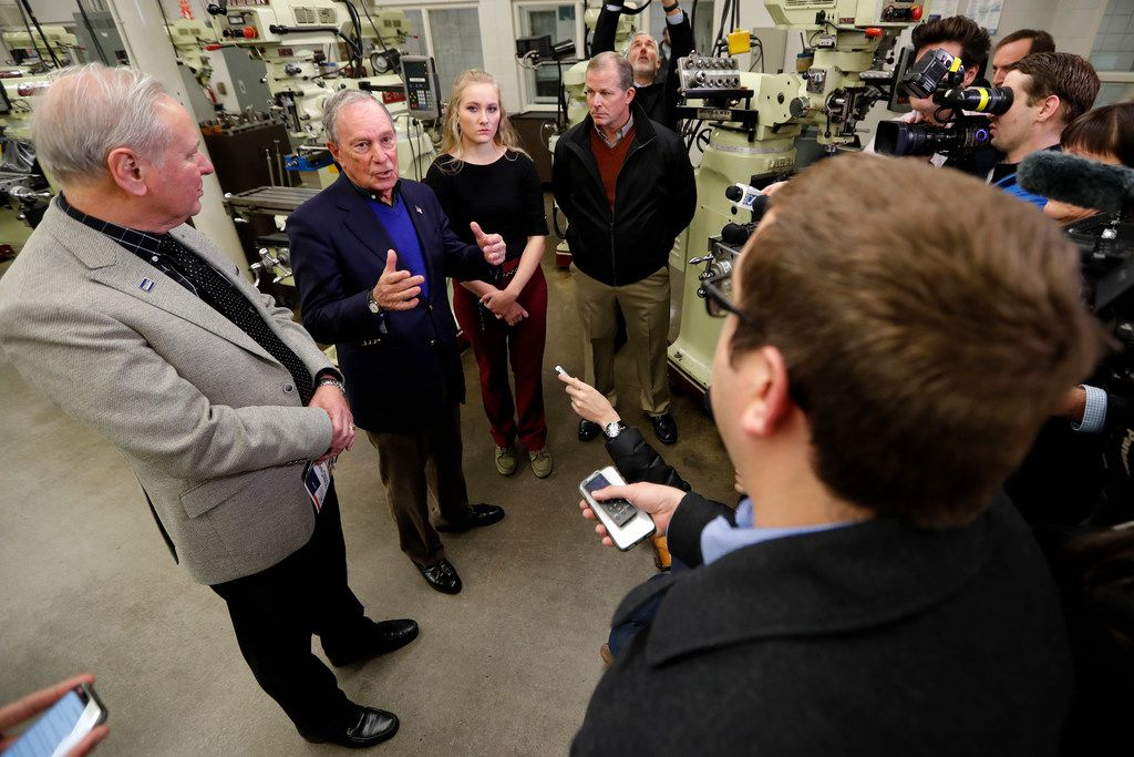 Former New York City Mayor Michael Bloomberg speaks to reporters after talking to students in the Wind Technology program at Des Moines Area Community College on Dec. 4, 2018, in Ankeny, Iowa.
