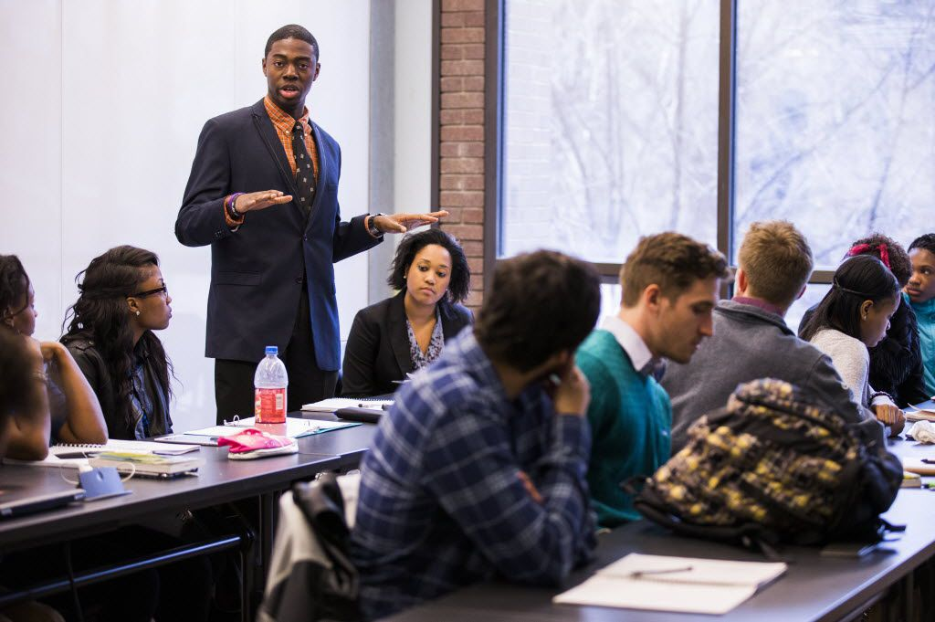 Paul Quinn College student Vincent Owoseni of Brooklyn, N.Y., speaks to other Paul Quinn College and Duke University students while they take a class from Duke Ph.D. student Danielle Purifoy on Jan. 22, 2015. (Ashley Landis/The Dallas Morning News)