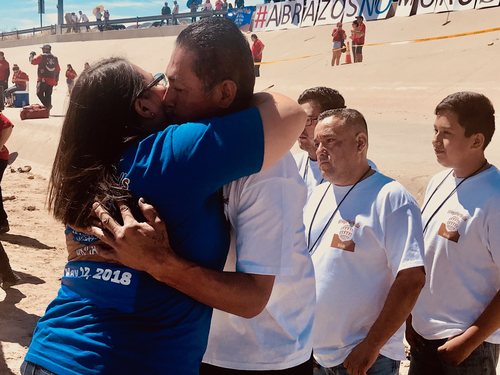Alejandra Guerrero Hernandez hugs her brother Humberto on Saturday, during a family reunification on the border.