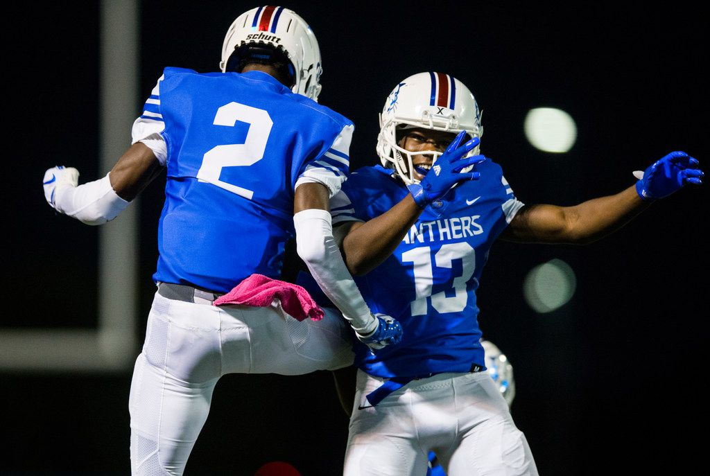 Duncanville defensive back Ennis Rakestraw, Jr. (2) celebrates with wide receiver Roderick Daniels (13) after Daniels scored a touchdown during the first quarter of a high school football game between Skyline and Duncanville on Friday, October 4, 2019 at Panther Stadium in Duncanville. (Ashley Landis/The Dallas Morning News)