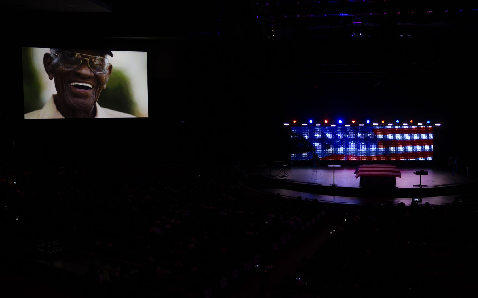 A photo of Richard Overton is displayed during a memorial service at Shoreline Church in Austin.
