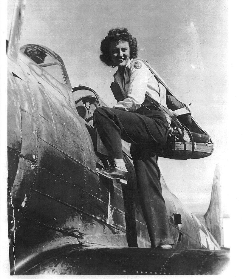 "Muriel ""Mimi"" Lindstrom Segall climbs into a plane during her service in the Women Airforce Service Pilots during World War II. Segall's son, Lindy, testified before the Texas State Board of Education on Nov. 13 in hopes of reversing the board's decision to cut the WASP from the public school social studies curriculum."